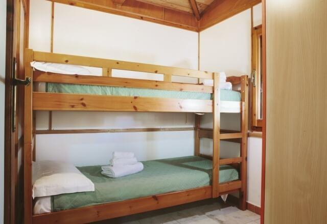 Bedroom with bunk beds in Bungalow Torre del Porticciolo